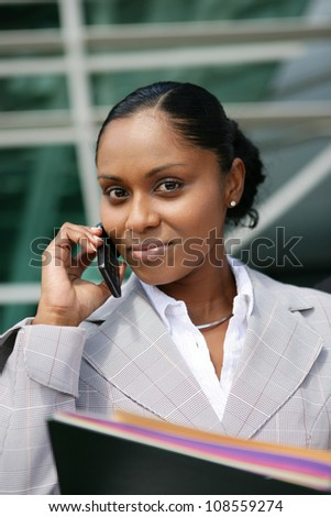 A businesswoman talking on her mobile phone - stock photo