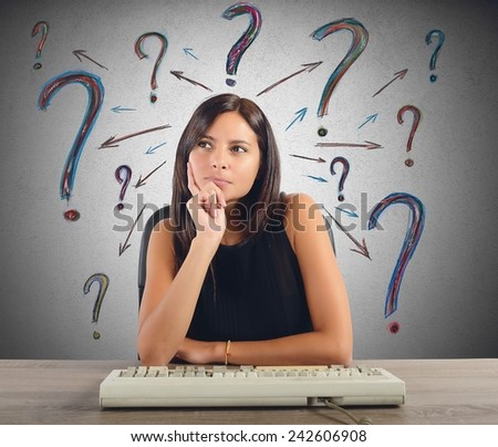 A businesswoman thinks and does the questions - stock photo