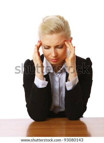 A businesswoman with a headache, sitting at the desk, isolated on white background - stock photo