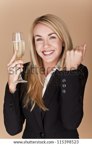 A businesswomen woman holding a glass of champagne at a party. Businesswomen celebrating.
