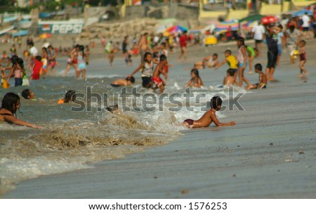 A busy beach - stock photo