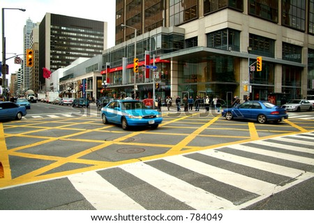 A busy downtown intersection. - stock photo
