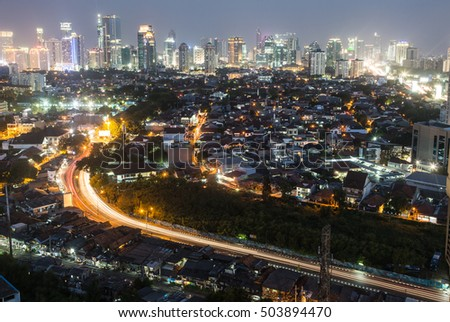 A busy road leading to Jakarta bright business district at night in Indonesia capital city.