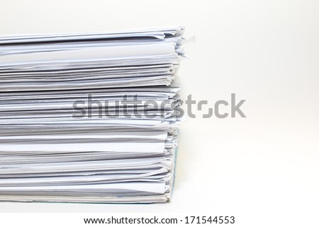 A busy sheets of paper stack on desk isolated.