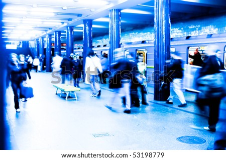 A busy subway station at rush hour. Long exposure high key effect shot. Incorrect white balance - stock photo