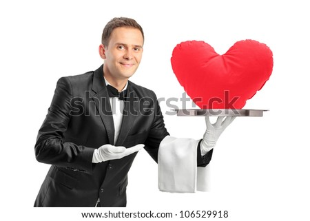 A butler holding a tray with a red heart shape object on it isolated on white background - stock photo