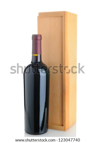 A Cabernet Sauvignon wine bottle standing in front of a wood box. Isolated on white with reflection. - stock photo