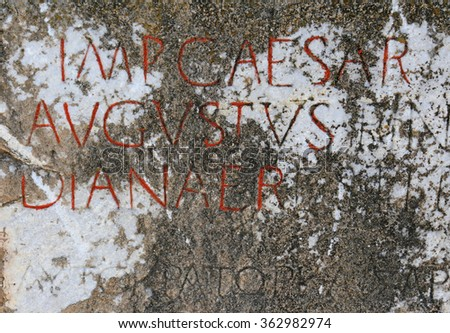 A Caesar Augustus inscription on a stone in the ancient city of Ephesus.  - stock photo