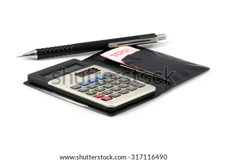 A calculator, a pen and Thai cash on isolated background. - stock photo