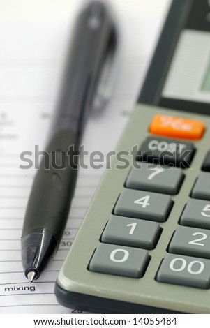 A calculator and ball-pen
