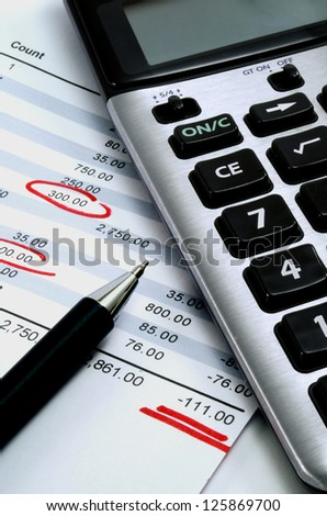 A calculator with a personal finance calculation sheet - stock photo