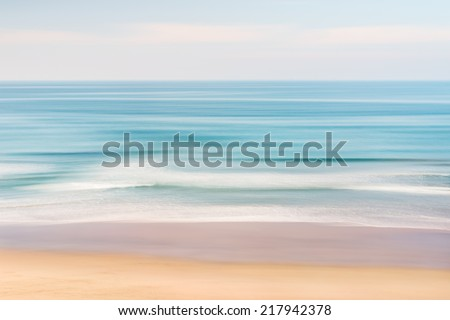 A California seascape with panned motion blur and pastel colors. - stock photo
