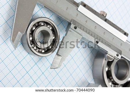 a calliper and a bearing on graph paper