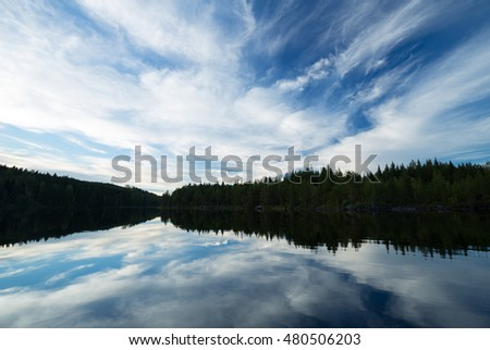 A calm lake in sweden, cloud reflections in the water