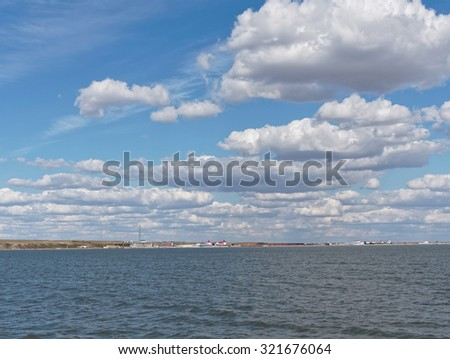 a calm lake under blue sky - stock photo