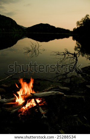A camp fire on an evening by a lake