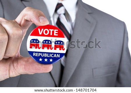 A campaigning politician showing his republican political badge during election season in the USA - stock photo