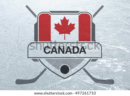A Canadian crest stamped onto the surface of an ice rink.