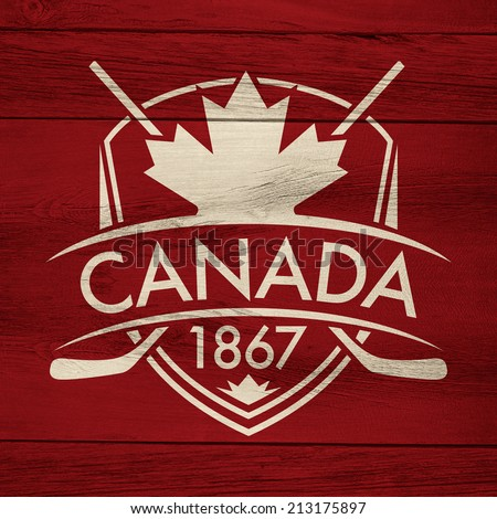 A Canadian hockey crest on a rustic wooden background.