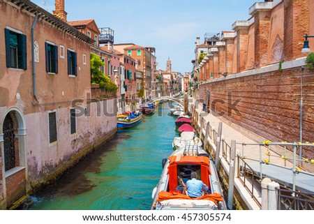 A canal with boats in Venice, Italy - stock photo