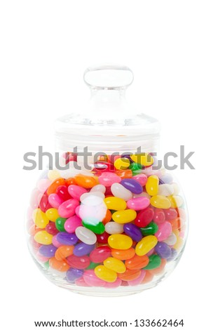 A candy jar full of jelly beans.  Shot on white background. - stock photo