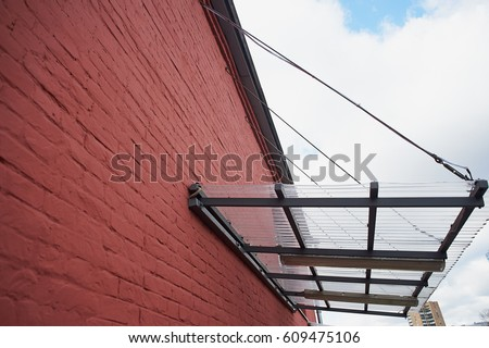 A canopy made of polycarbonate on metal base mounted on a red brick wall : canopy polycarbonate - memphite.com