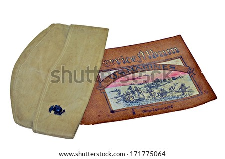 A cap and service album from Camp Lejeune, NC, during WW II, 1940s. - stock photo