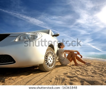 a car and a young man on the beach