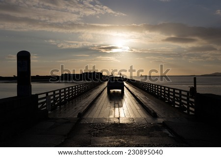 A car crossing Bull Bridge at Dollymount early morning - stock photo