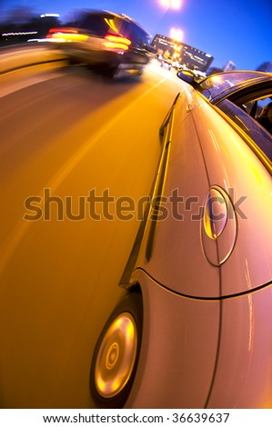 a car driving in the busy downtown streets, with taking a right turn, passing, and anticipating other traffic - stock photo