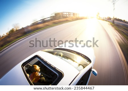 A car driving on a motorway at high speed
