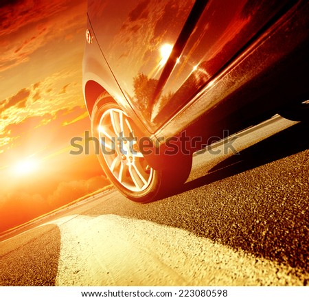 A car driving on a motorway at high speeds, overtaking other cars - stock photo