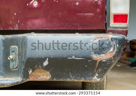 A car has a dented rear bumper after an accident/Damage/Car Accident - stock photo