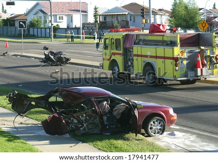 A car involved in an accident rests on the side of the road. - stock photo