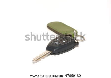 A car key with remote unlocking on a white background