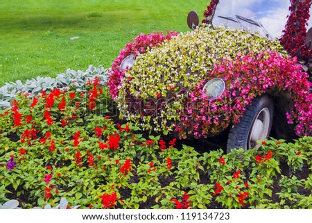 a car maded from lot of flowers