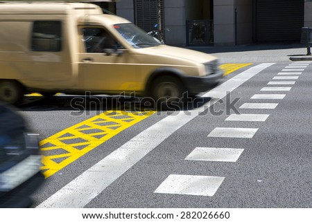 A car moving over pedestrian way. - stock photo