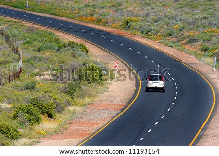 A Car on a lonely road in South Africa - stock photo