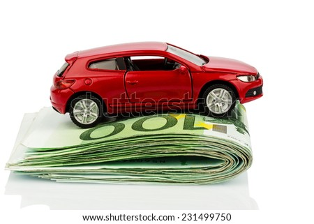a car standing on euro bills. costs for the purchase of automobiles, gasoline, insurance and other car costs - stock photo