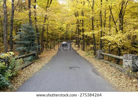 A car traveling on scenic Route 29 in New Jersey - stock photo