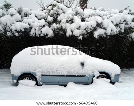 A car under the snow - stock photo