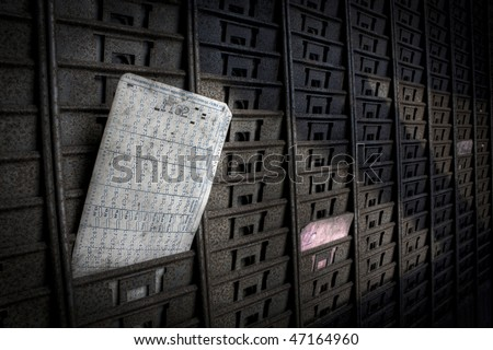 A card for control over working time, in an grunge scenery - stock photo