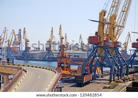 A cargo container ships and cranes is docked at the shipyard. - stock photo