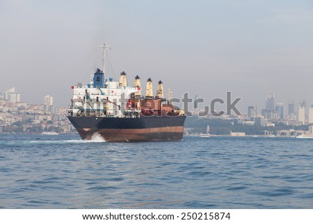 A cargo ship carrying goods between ports - stock photo