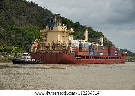 A cargo ship is heading to the Atlantic side of the Panama Canal. Panama,Central America. - stock photo