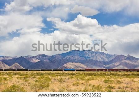 A cargo train traveling through the Mojave desert in Arizona. - stock photo