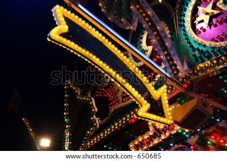 A carnival arrow in yellow - stock photo