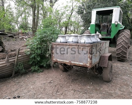 A cart full of Cans of milk in a family farm