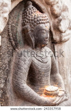 A carving of buddha in Nepal. - stock photo