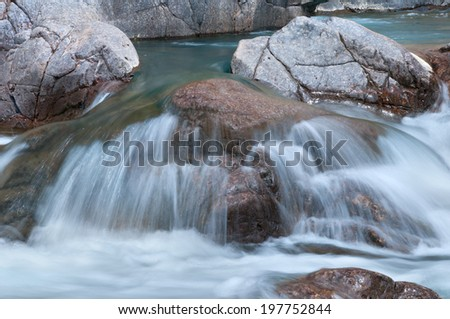 A cascade and rocks on the Black River in Johnson Shut-ins State Park, Missouri. - stock photo